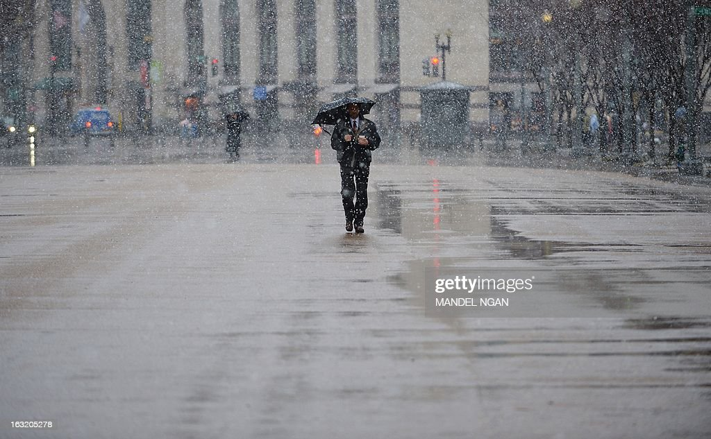 A man walks down Pennsylvania Avenue in snowfall on March 6, 2013 in Washington, DC. A winter storm warning remains in effect until early Thursday. A massive winter storm pounding the northern United States Tuesday grounded 2,600 flights, closed hundreds of schools and made roadways and highways impassible. At least four people were reportedly killed in accidents on icy and snow covered roads and highways. More than a dozen states from Minnesota to Virginia were in the path of the huge storm, which had already dumped as much as two feet (60 centimeters) of snow in Montana and 15 inches (38 centimeters) in North Dakota. Mandel NGAN