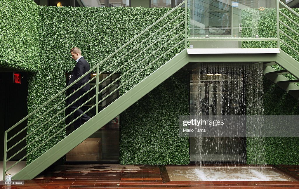 A man walks down stairs next to a waterfall at a new gay resort hotel, THE OUT NYC, in midtown Manhattan after the ribbon-cutting ceremony on March 1, 2012 in New York City. The 105-room gay urban resort, which is 'straight-friendly,' is set to open March 1 in the Hell's Kitchen neighborhood and features a nightclub, spa, restaurant and outdoor spaces. It is being billed as New York City's first gay hotel.