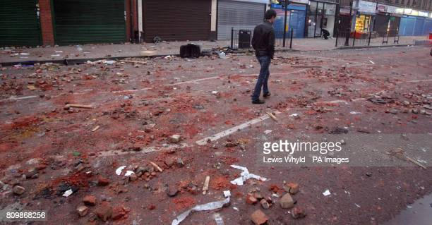 A man walks down the High Road in Tottenham north London the morning after trouble flared after members of the community took to the streets last...