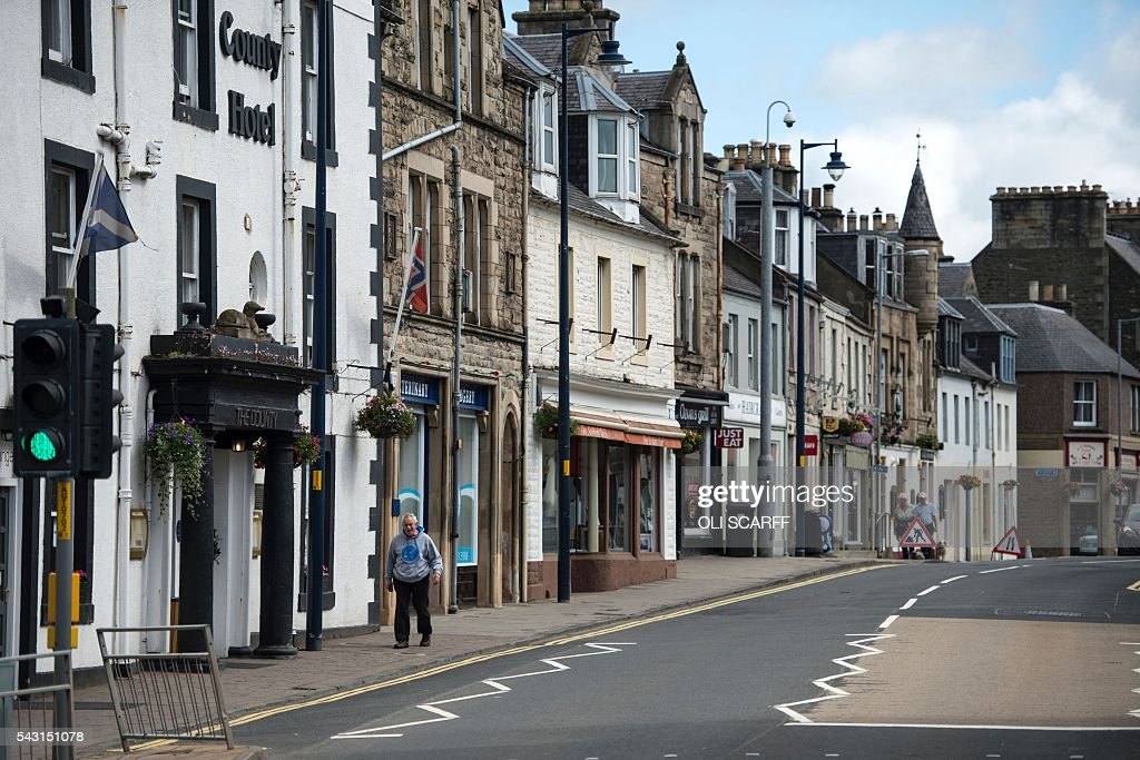 A man walks down the high street of the border town of Selkirk in Scotland close to the border between England and Scotland on June 26, 2016. Scotland's First Minister Nicola Sturgeon campaigned strongly for Britain to remain in the EU, but the vote to leave has given the Scottish National Party leader a fresh shot at securing independence. Sturgeon predicted more than a year ago that a British vote to leave the alliance would give pro-European Scots cause to hold a second referendum on breaking with the UK. SCARFF