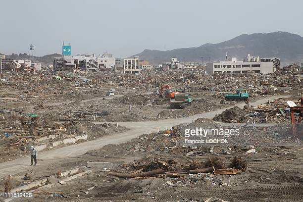 A man walks down the road amid the debris April 2 2011in Rikusen Takata City Japan The 90 magnitude strong earthquake struck offshore on March 11 at...