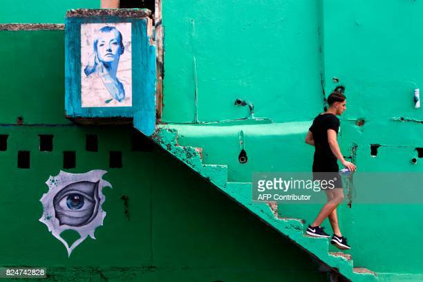 A man walks down the stairs in the neighbourhood of La Perla where the video 'Despacito' was recorded in San Juan on July 22 2017 Something unusual...