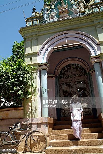 A man walks down the steps of a mansion gate lushly adorned with religious motifs in Karaikudi in the Chettinad region of Tamil Nadu Numbering more...