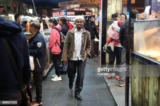 A man walks down the street during a street festival in the southwestern suburb of Lakemba on May 27 2017 in Sydney Australia Muslims around the...