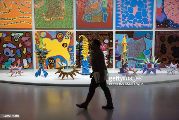 A man walks during a preview of the Yayoi Kusama's Infinity Mirrors exhibit at the Hirshhorn Museum February 21 2017 in Washington DC / AFP / Brendan...