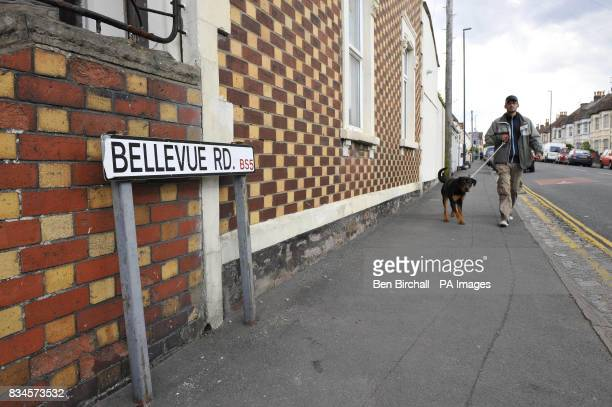 A man walks his dog in Belle Vue Road Easton Bristol as police search a property on the street following the arrest of a 19yearold man under the...