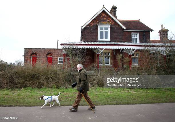 A man walks his dog past Hellingly Station on the former Cuckoo Line railway in East Sussex As passenger numbers decreased during the 1960s promoting...