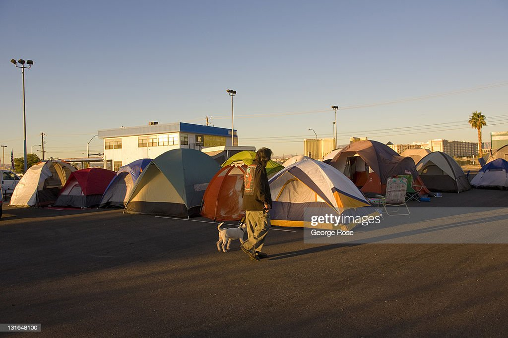 A man walks his dog past the tents at the Occupy Las Vegas camp on October 23, 2011 in Las Vegas, Nevada. Located a vacant lot across from the University of Nevada near McCarran International Airport, the turnout by protesters appeared on this day to be low.