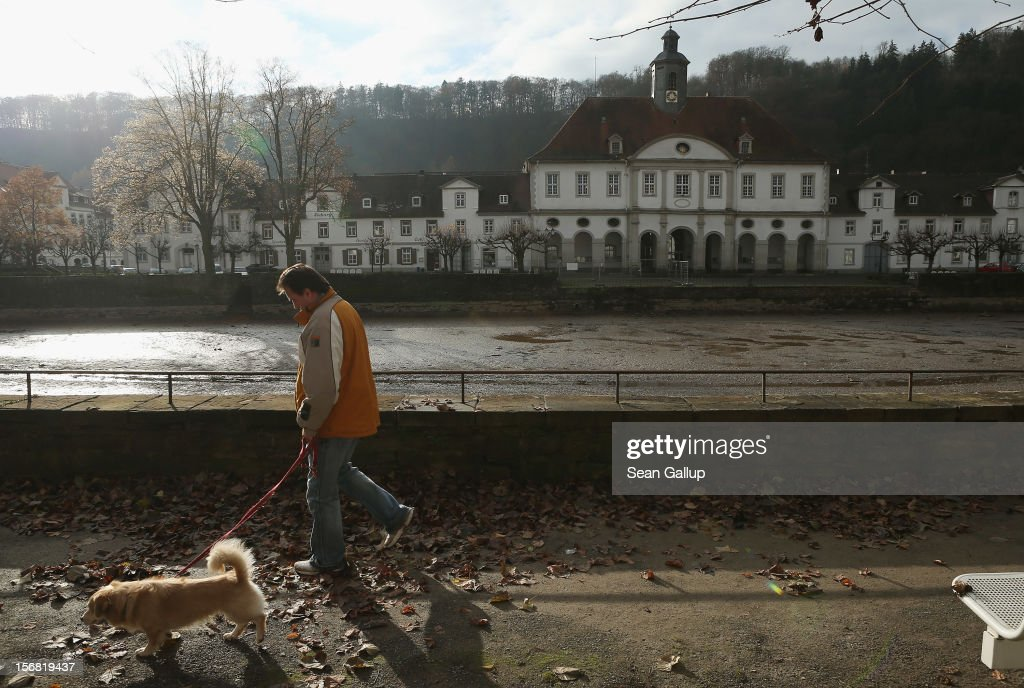 A man walks his dog past town hall on November 19, 2012 in Bad Karlshafen, Germany. Bad Karlshafen was heavily settled by Huguenot refugees in the early 18th-century and lies along the 'Fairy Tale Road' (in German: Die Maerchenstrasse) that leads through the region between Frankfurt and Bremen where the Grimm brothers collected and adapted most of their fairy tales, which include such global classics as Sleeping Beauty, Little Red Riding Hood, Rapunzel, Cinderella and Hansel and Gretel, in the early 19th century. Among the most important sources for many of the tales was Huguenot descendant Dorothea Viehmann.The 200th anniversary of the first publication of the stories will take place this coming December 20th.