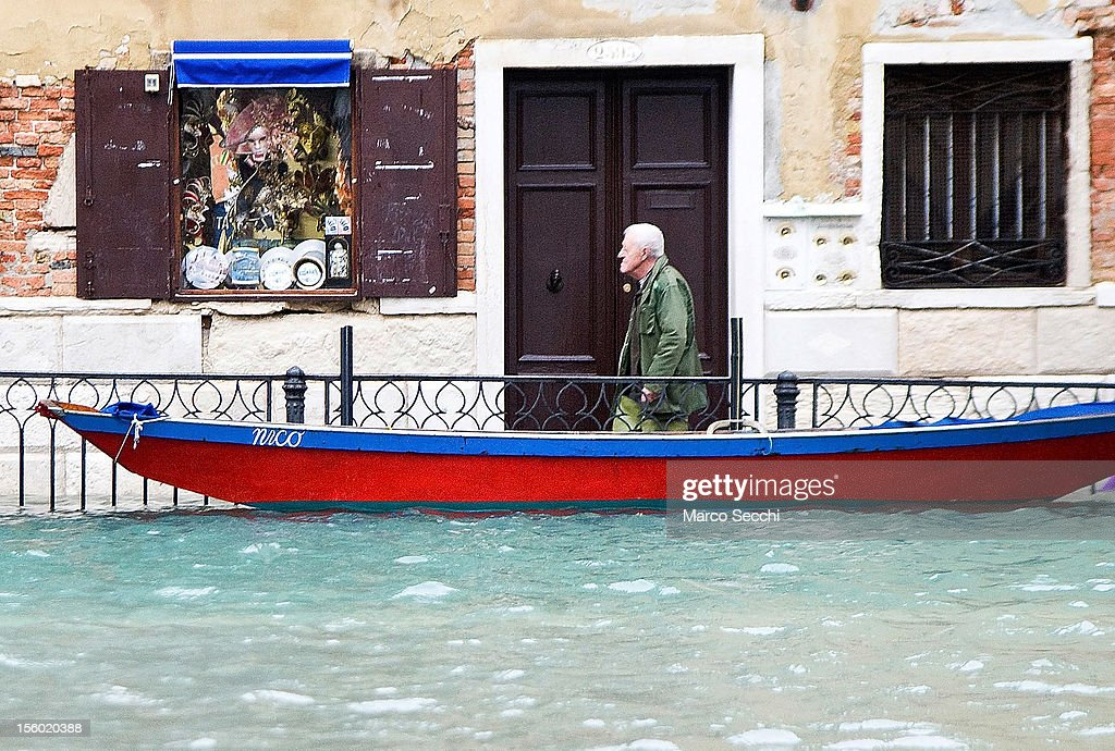 A man walks in a calle during the exceptional High Water on November 11, 2012 in Venice, Italy. More than 70% of Venice has been been left flooded, after the historic town was hit by exceptionally and unexpected high tide. The sea level rose very quickly to 150 due as well to strong southerly wind and heavy rain.