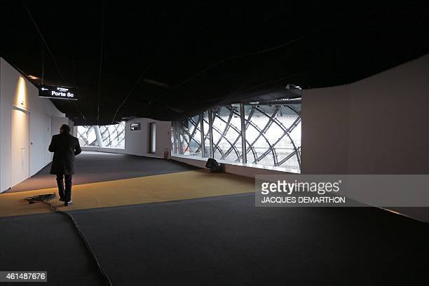 A man walks in a corridor at the new Philharmonie de Paris ahead of its opening in Paris on January 13 2015 The Philharmonie de Paris opens on...