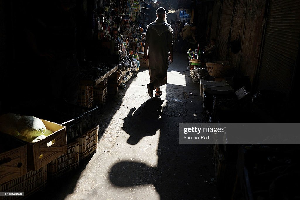 A man walks in a market on June 29, 2013 in Tripoli, Lebanon. Tripoli, Lebanon's second largest city, has suffered from the spillover of Syria's two-year-old war. In the past month alone, over 30 people have been killed in Tripoli in battles between pro-Syrian government partisans against those supporting the Syrian rebels. Currently the Lebanese government officially hosts 546,000 Syrians with an estimated additional 500,000 who have not registered with the United Nations. Lebanon, a country of only 4 million people, is now home to the largest number of Syrian refugees who have fled the conflict. The situation is beginning to put a huge social and political strains on Lebanon as there is currently no end in sight to the war in Syria.