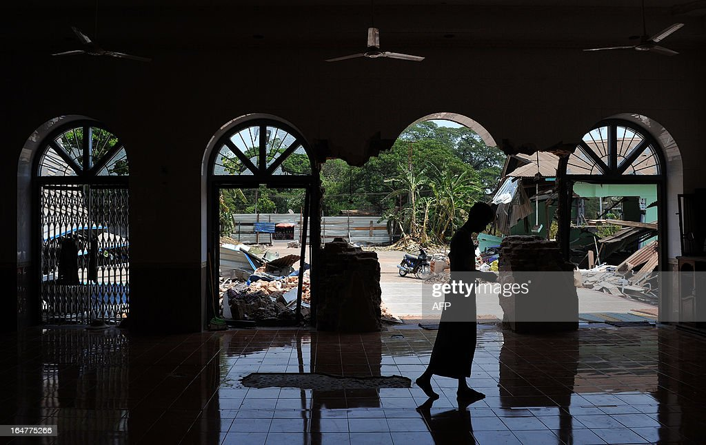 A man walks in a partially-destroyed mosque after sectarian violence spread through central Myanmar, in Gyobingauk, Bago division on March 28, 2013. Myanmar's Muslim leaders have appealed to President Thein Sein to take swift action to quell religious violence, accusing security forces of standing by as rioters went on a rampage. AFP PHOTO/Ye Aung THU