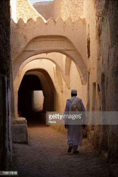 A man walks in a small street April 2000 in Ghadames Libya