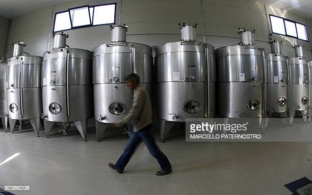 A man walks in a wine cellar in the 'Centopassi' factory in San Cipirello on October 27 2009 during the official opening ceremony Libera an Italian...
