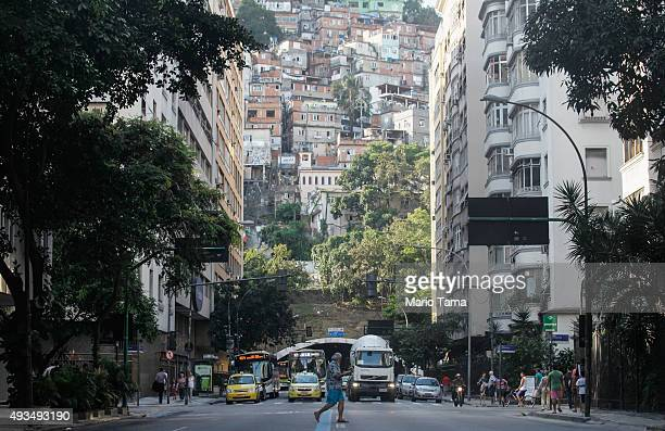 A man walks in Copacabana on October 20 2015 in Rio de Janeiro Brazil Residential real estate prices dropped in Brazil's top 20 cities in August for...