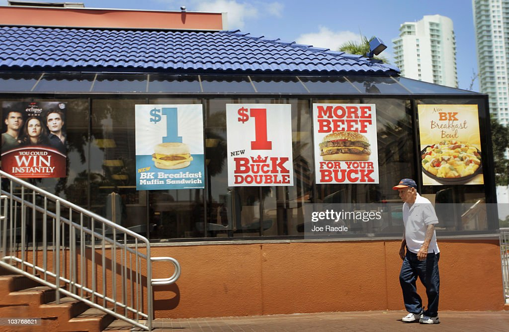 A man walks in front of a Burger King restaurant as reports indicate the company may be considering a sale of itself on September 1, 2010 in Miami, Florida. Burger King is the second-largest hamburger chain in the United States.