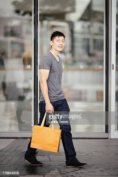 A Man walks in front of a mall