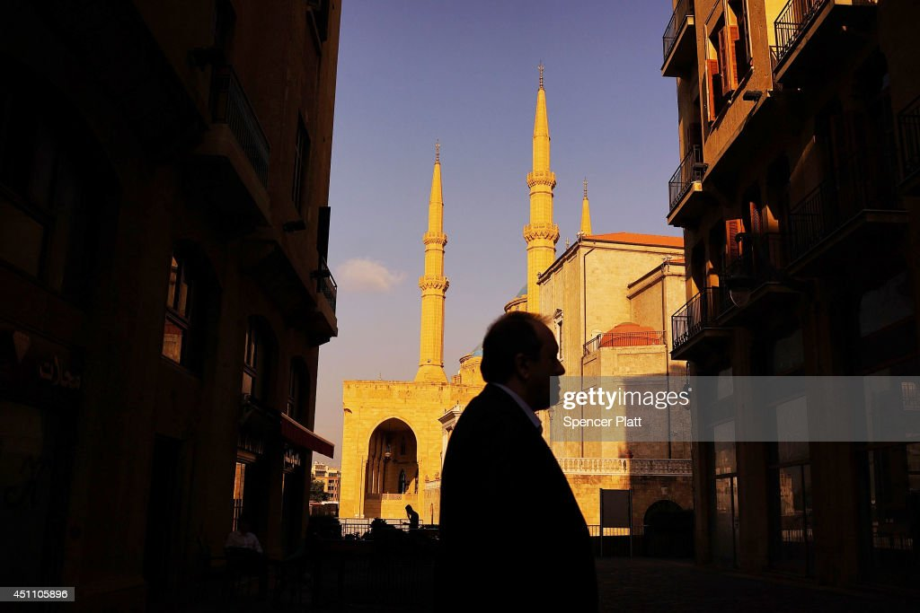 A man walks in front of a mosque at the start of the summer season for the Mediterranean city on June 23 2014 in downtown Beirut Lebanon While...