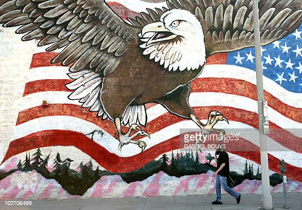 A man walks in front of a mural in West Los AngelesCalifornia 22 October 2006 Until the 1960s public murals in Los Angeles were few and far between...