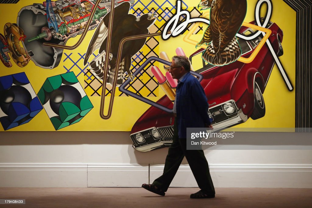 A man walks in front of a piece of work entitled 'The Randon Illusion No 6' by Peter Phillips at Sotheby's auction house on September 3, 2013 in London, England. The piece makes up part of 'The New Situation' exhibition, comprising of 1960's British Art including paintings by David Hockney and Bridget Riley. The exhibition runs at the auction house until September 11.