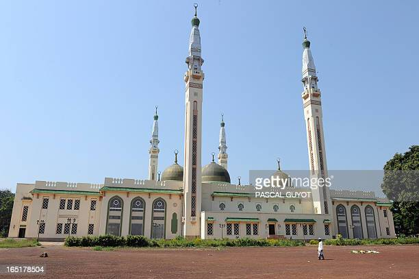 A man walks in front of the Great Mosque on December 2 2010 in Conakry as Guinea waited anxiously today for the Supreme Court to confirm presidential...