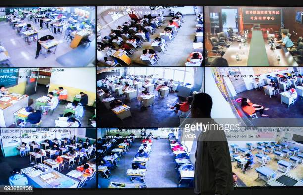 A man walks in front of the monitor at the provincial exam command center on the first day of national college entrance examination on June 7 2017 in...