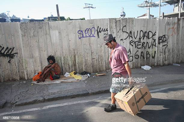 A man walks in front of the new gondola which travels to the top of the Providencia community or favela on September 23 2015 in Rio de Janeiro Brazil...