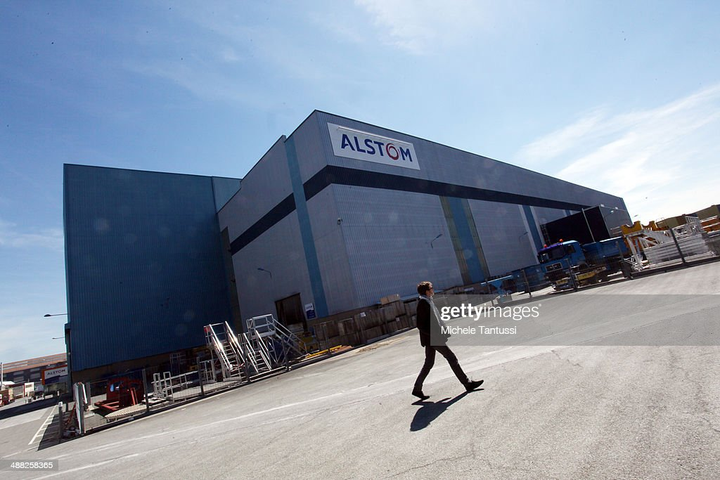 A man walks in front of the production plant of engineering firm Alstom S.A. on May 5, 2014 in Belfort, France. General Electric is seeking to take over Alstom, one of its main competitors, and so far a counter move by Siemens to buy Alstom instead seems more and more unlikely.