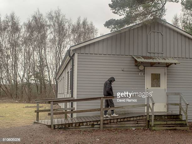A man walks in his barrack in an asylum seekers' temporary camp in the Strandparken Ostra Straden summer holidays resorts on February 9 2016 in...