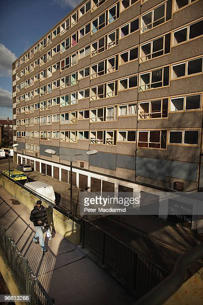 A man walks in late afternoon sunshine on the Heygate housing estate near Elephant and Castle on February 11 2010 in London England The Heygate...