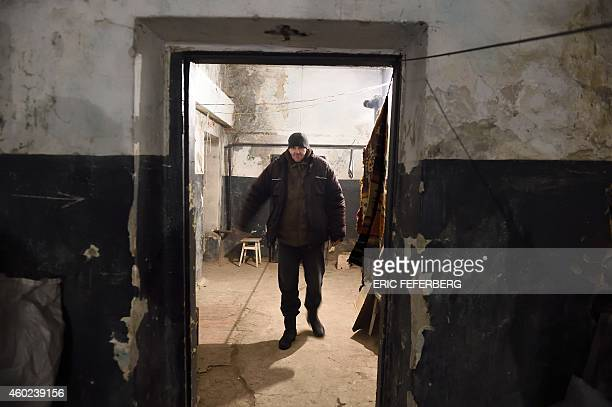 A man walks in the cellar of his building used as a shelter in Kievskiy district witch is often sheld in the eastern Ukrain city of Donetsk...