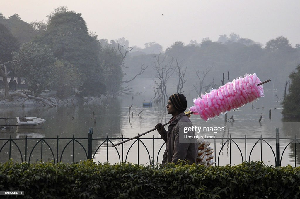 A man walks in the Hauz Khas Complex on a chilly evening on January 3, 2013 in New Delhi, India. A cold wave is sweeping across north India sending temperatures plunging. Delhi Wednesday witnessed the coldest day in the past 44 years.