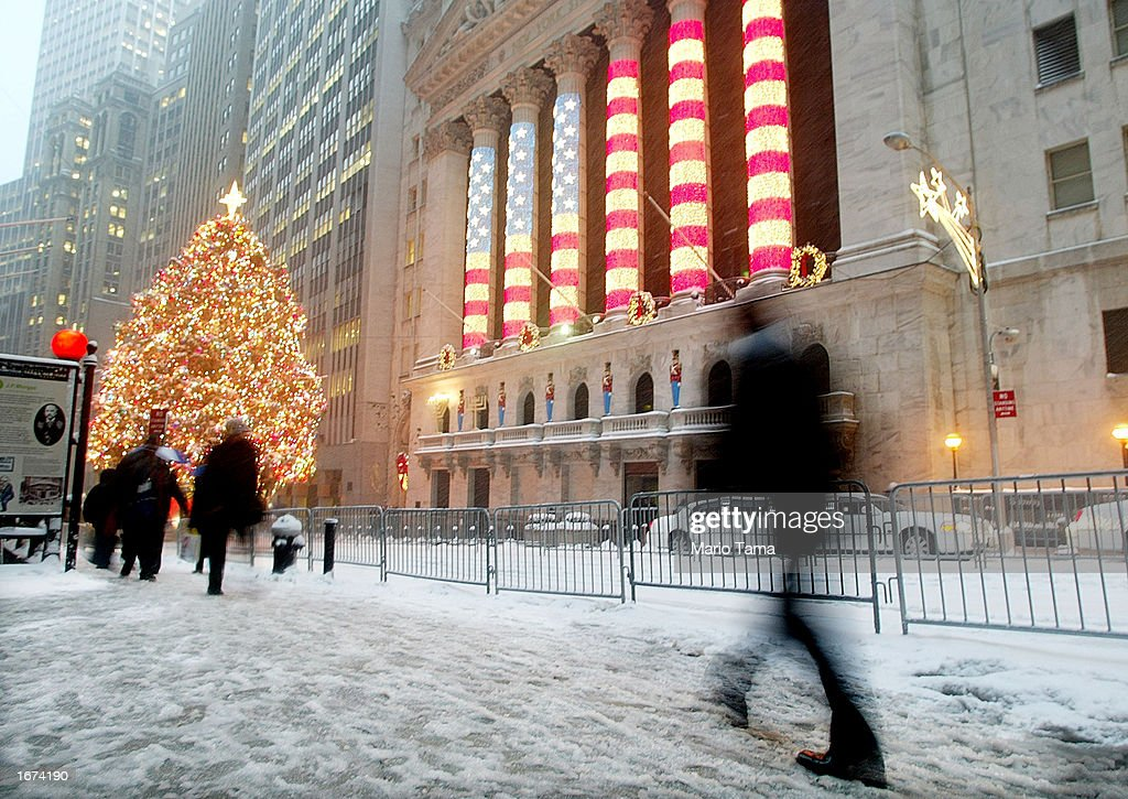 front of the New York Stock Exchange (NYSE) Christmas tree and holiday ...