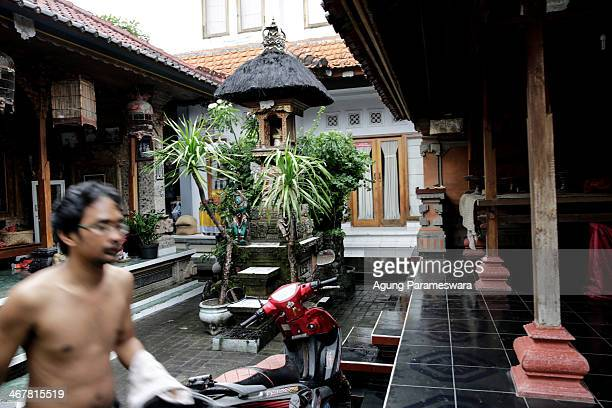 A man walks infornt of a house where Australian drug trafficker Schapelle Corby's sister and brother in law Mercedes Corby and Wayan Widyartha live...