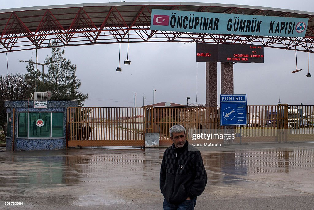 A man walks infront of the closed Turkish border gate on February 6, 2016 in Kilis, Turkey. According to Turkish officials some 35,000 Syrian refugees have massed on the Syrian/Turkish border after fleeing Russian airstrikes and a regime offensive surrounding the city of Aleppo in northern Syria.