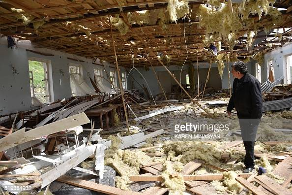 A man walks inside a destroyed building in the village of Talish some 80km north of Karabakh's capital Stepanakert on April 6 2016 The global...