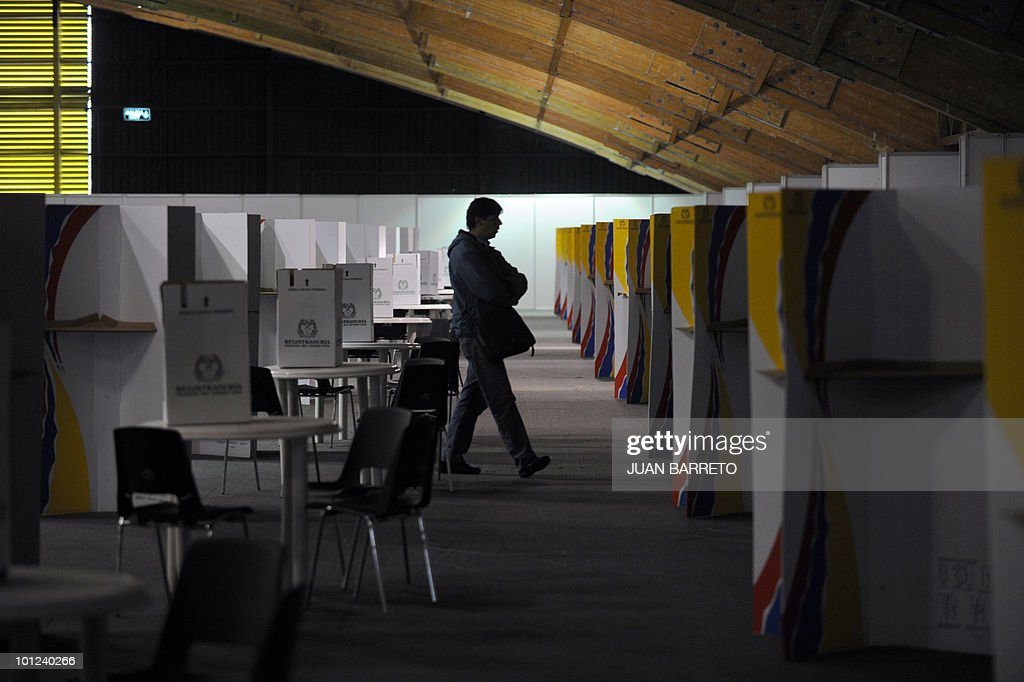 A man walks inside a polling station in Bogota on May 28, 2010. Colombia will hold presidential elections next May 30, and according to polls, a run-off election between Antanas Mockus for the Green Party and Juan Manuel Santos for the ruling National Unity Party, will take place on June 20.