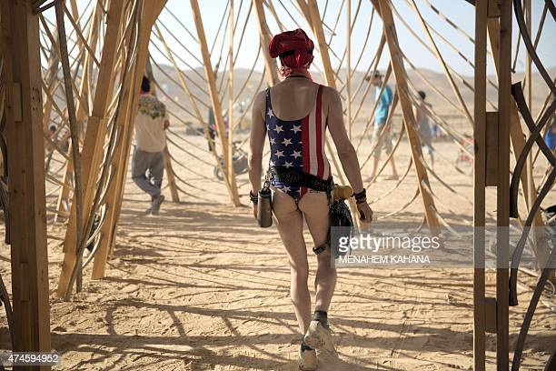 A man walks inside a Temple structure during the 2015 Midburn festival in the Negev Desert near the Israeli kibbutz of Sde Boker on May 21 2015 Some...