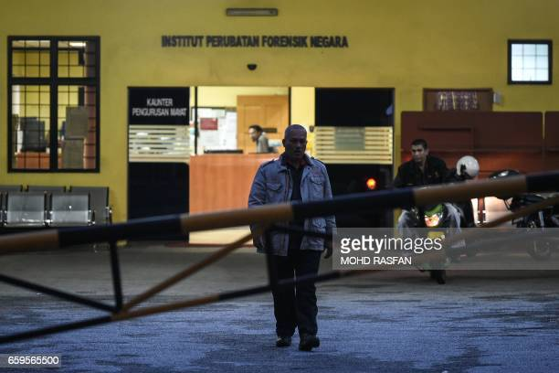 A man walks inside the forensics wing of the Hospital Kuala Lumpur where the body of Kim JongNam halfbrother of North Korea's leader Kim JongUn lies...