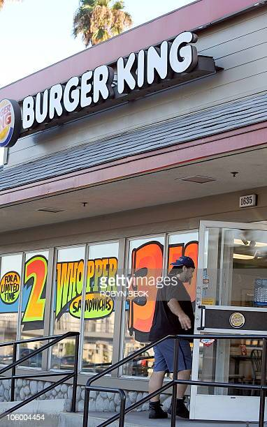 A man walks into a Burger King restaurant in Glendale California on September 2 2010 Burger King the secondlargest US hamburger chain will be sold to...