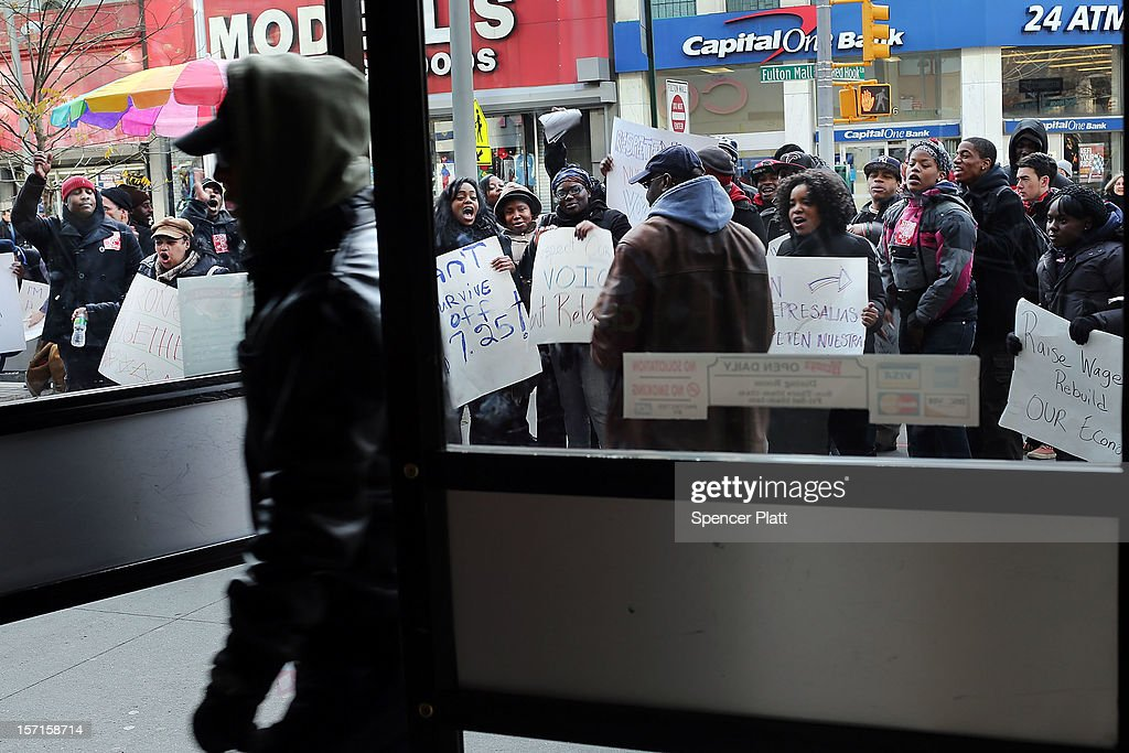 A man walks into a Wendy's as protesters, many of them employees at Wendy's fast-food restaurant, demonstrate outside of one of the restaurants to demand higher pay and the right to form a union on November 29, 2012 in New York City. The campaign, called 'Fast Food Forward,' organized protests at other New York fast-food establishments including McDonald's, Burger King, KFC, Pizza Hut, Taco Bell and Domino's. The group seeks to double hourly pay to $15 an hour .