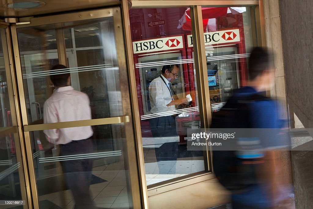 A man walks into an HSBC Bank branch at 26 Broadway August 1, 2011 in New York City. According to reports. HSBC will eliminate 30,000 jobs worldwide and sell 195 branches, mostly in upstate New York, to First Niagara Financial for about $1 billion.