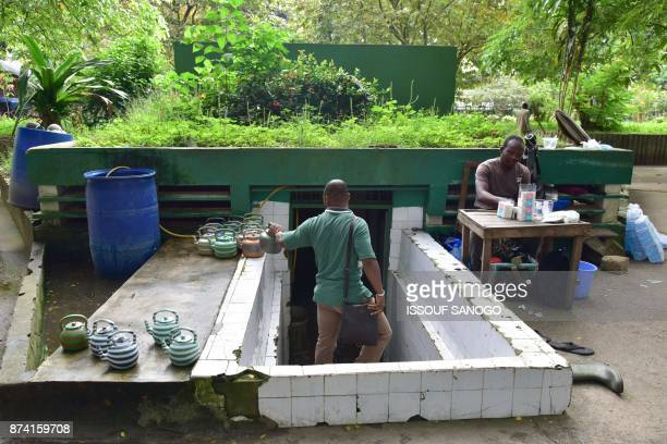 A man walks into public toilets in the Plateau business district of Abidjan on November 14 2017 / AFP PHOTO / ISSOUF SANOGO
