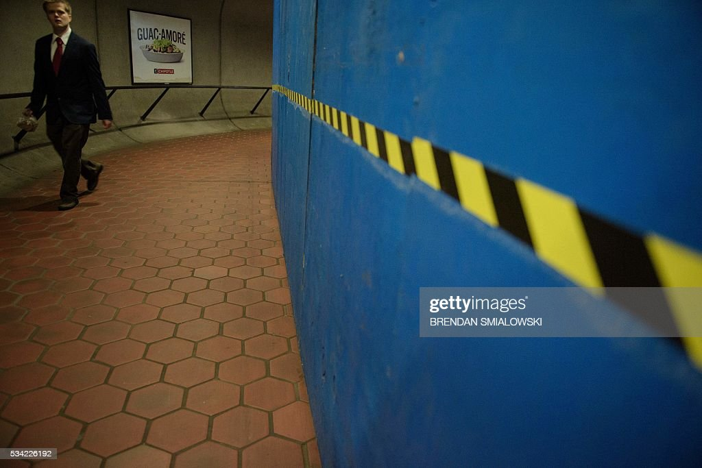 A man walks into the Van Ness UDC Metro during escalator repairs in the Metro transit system May 25, 2016 in Washington, DC. / AFP / Brendan Smialowski