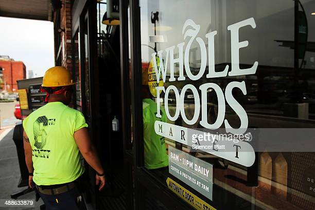 A man walks into Whole Foods Market in the Brooklyn borough on May 7 2014 in New York City Whole Foods Market an upscale grocery store that sells...