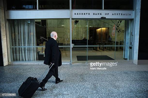 A man walks intothe Reserve Bank of Australia headquarters on May 5 2015 in Sydney Australia Forecasters are predicting the Reserve Bank of Australia...