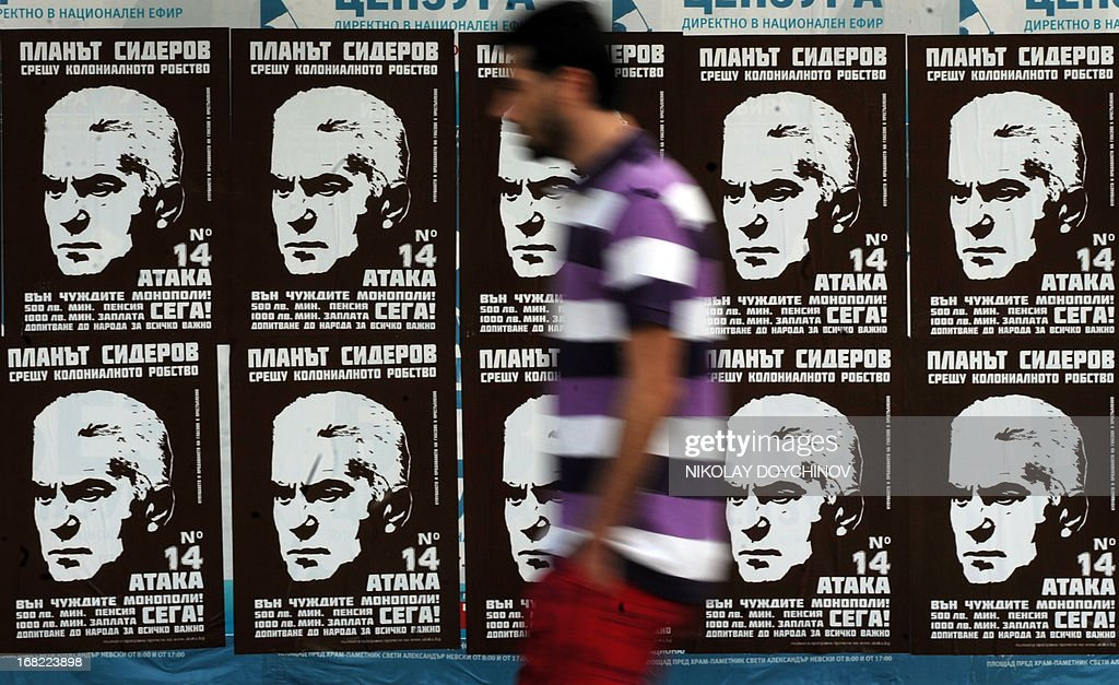 A man walks next to election campaign posters supporting Volen Siderov, leader of the ultra-nationalist Ataka party, in Sofia on May 07, 2013. A winter of discontent in Bulgaria, when mass protests forced out the government, could give way to a spring of political deadlock and instability after elections Sunday in the EU's poorest country.