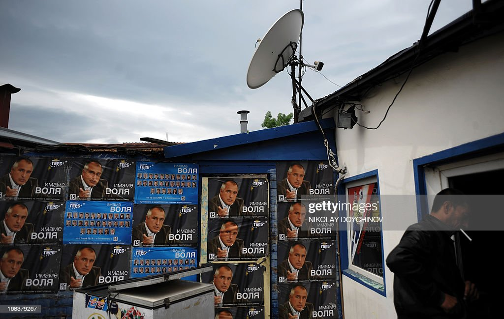 A man walks next to election posters of the former Bulgarian prime minister and leader of conservative GERB party in Sofia on May 9, 2013. A winter of discontent in Bulgaria, when mass protests forced out the government, could give way to a spring of political deadlock and instability after elections on May 12 in the EU's poorest country. Five Bulgarian opposition parties said on May 7 that they have commissioned a parallel independent count of votes in Sunday's snap parliamentary election because of worries about irregularities.