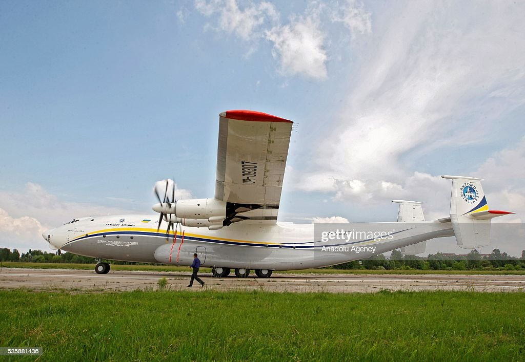 A man walks next to the aircraft 'AN-22' ('Antaeus') before a demonstration flight from the airfield 'Svyatoshin' (Kiev) to the airport 'Kyiv-Antonov' (Hostomel) in Kiev, Ukraine on May 30, 2016. Ukrainian aircraft 'AN-22' is restored on the aircraft factory 'Antonov' and returned to commercial operation. The 'AN-22' is the world's first wide-body transport plane and the world's largest turbo-prop airplane.